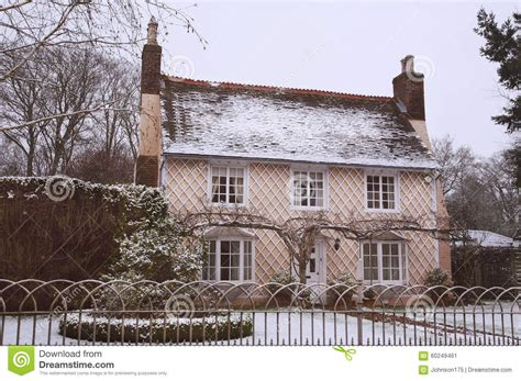 Tiny House Cottages english country cottage in the winter snow stock photo