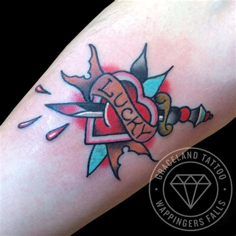 traditional heart tattoo traditional and dagger by adam lauricella