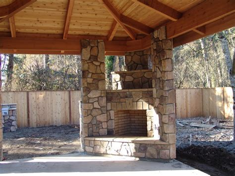 bbq and fireplace outdoor fireplace with bbq grill and pizza oven traditional portland by brown bros masonry