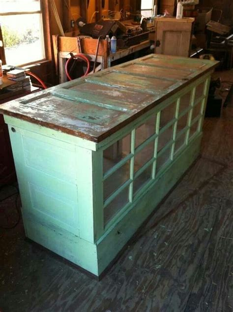 old door turned into glass top table corner command center pinter kitchen island made from old doors and windows love this