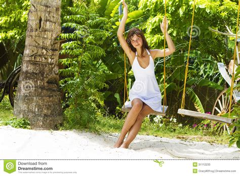 swinging naturals young beautiful woman swinging stock photos image 31112233