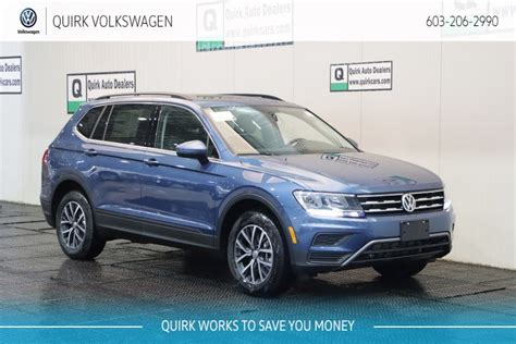 volkswagen tiguan sesunroofrd row seat sport utility  manchester  quirk