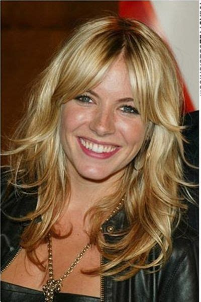 middle fringe hairstyle sienna s hairstyle is long thick and curly her hair is