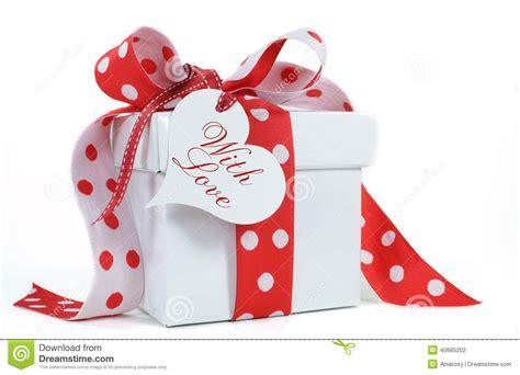 red and white polka dot theme gift box present stock photo