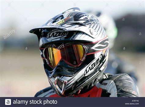 motocross racing helmets motocross rider in helmet and visor on the grid before