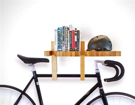 this book shelf also functions as bike rack hooks and