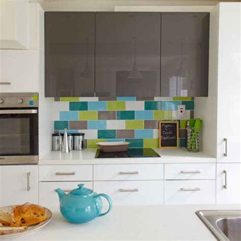 green and blue metro tile splashback practical kitchen