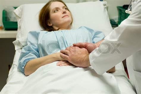 doctor comforting patient doctor comforting patient in hospital stock photo