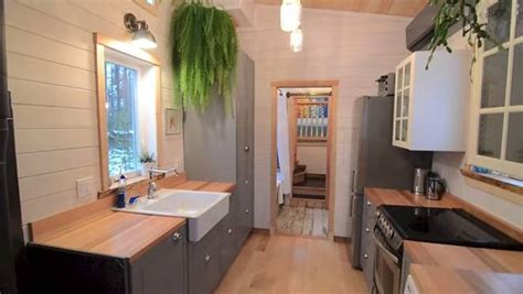 gooseneck trailer tiny house impressive 380 sq ft tiny home has extra tall bedroom built over gooseneck trailer