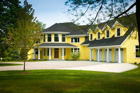 yellow house traditional exterior by widing custom homes
