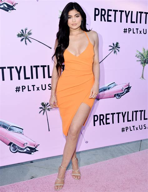 Keylie Dress jenner stuns in a 35 tangerine wrap dress instyle