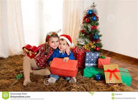 Little Kids On Rug Opening Christmas Presents Stock Photo ... Happy Kids Opening Christmas Presents