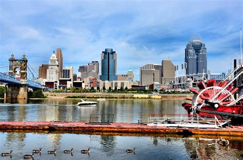 boat tours cincinnati downtown skyline ohio river paddle streamer boat and