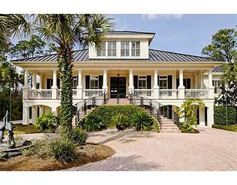low country house low country home with hip roof and large dormer exterior