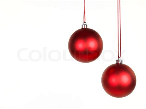 hanging christmas ornaments isolated against a white