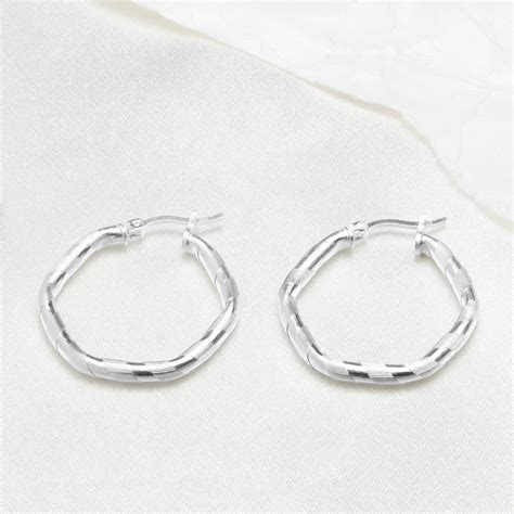 Geometric Hoop Earrings two textured geometric sterling silver hoop earring by the
