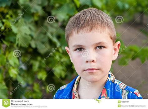 8 year old boy portrait of serious 8 year old boy royalty free stock