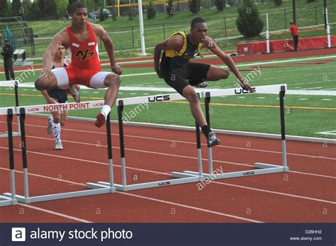 how to your to jump hurdles jump the hurdles in a track and field event in laplata stock photo royalty free