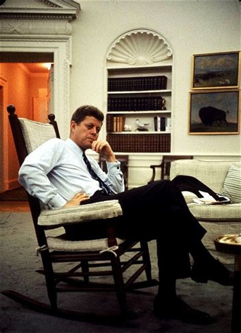 home to jfk pres john f kennedy sitting in rocking chair in his