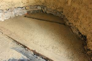 installing an earthen floor into our cob cottage