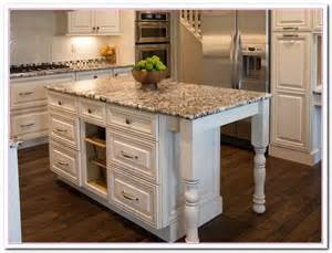 white kitchen island with top white colored kitchen and granite countertop selection