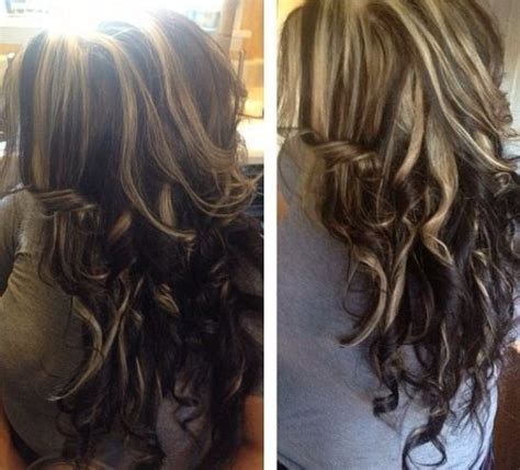 chunky hair style and color highlights on top dark underneath black hair with blonde
