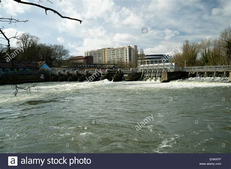thames lock and weir at reading the weir across the river thames at reading stock photo