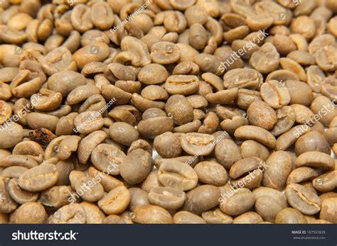 Green Bean Black Honey Specialty Arabica Coffee green unroasted arabica coffee beans stock photo 187593839