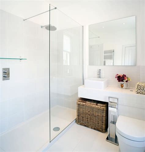small bathroom with big shower bottom of shower simple minimalistic look ensuite
