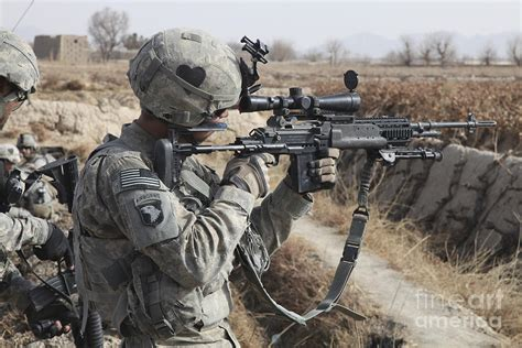 operation enduring freedom definition a u s army soldier looks photograph by stocktrek images