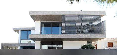 Sunken Kitchen sleek athens house blends stone with concrete textures