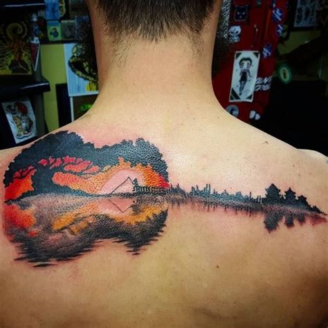 your tattoo chords 27 guitar tattoos you ll either love or hate