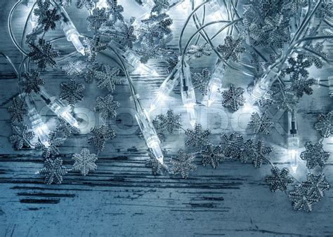 christmas lights decoration with silver snowflakes on