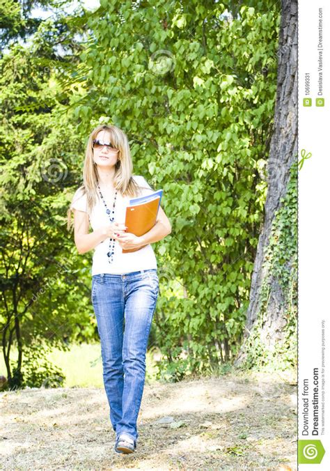 walking with your books student with books walking in park stock image image
