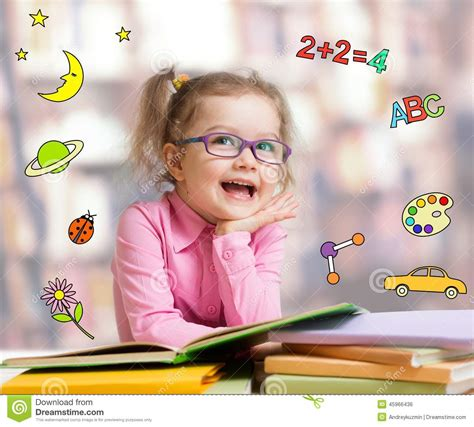 is the smart kid yours books smart kid in glasses reading book stock photo