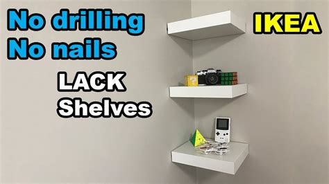 how to anchor a bookcase without drilling ikea lack shelf no drilling no nails on wall youtube