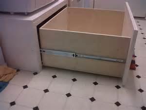white washer dryer pedestal platform with
