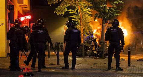 barcelona unrest barcelona sees third night of riots as police evict