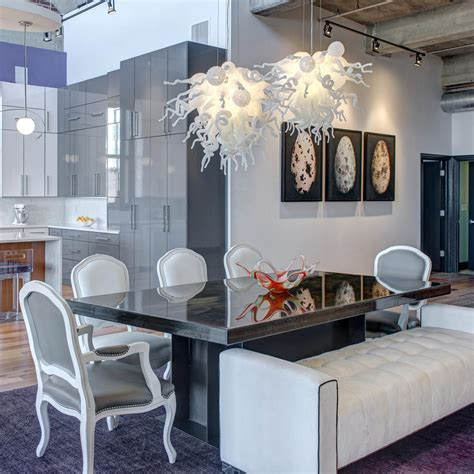 glass blown chandeliers  eclectic dining room hgtv