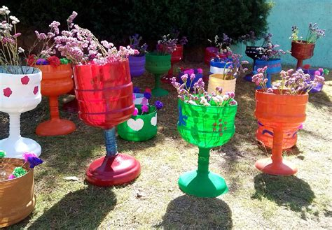 floreros hechos de llantas hablando de elefantes rosas ideas diy quot reciclaje quot