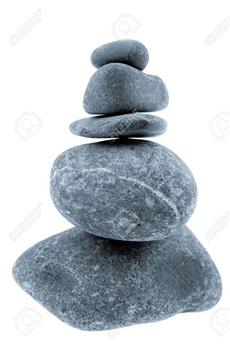 river rocks stacked on white background stones zen
