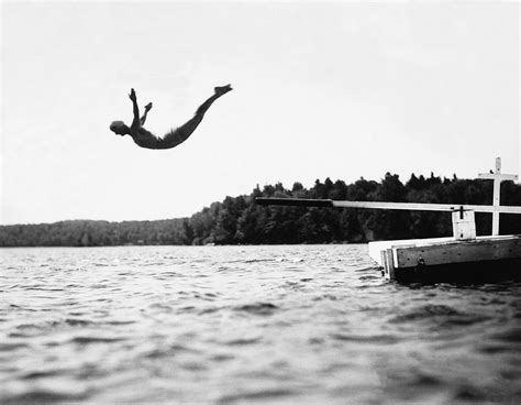 swan dive big pond swan dive photograph by underwood archives