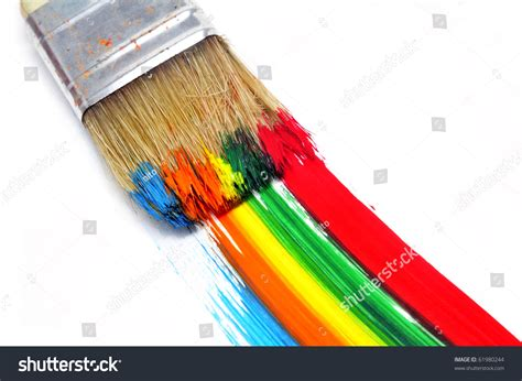 a brush with paint and brushstrokes of different colors in a white background stock photo
