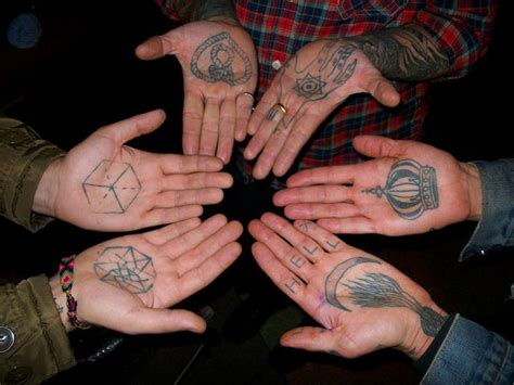 tattoo on palm of hand symbol ancient three on inside of
