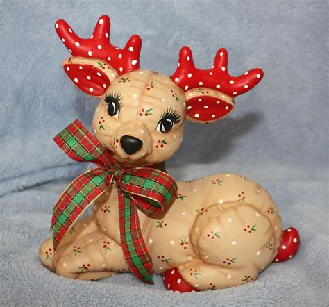 handpainted ceramic christmas reindeer laying painted with a