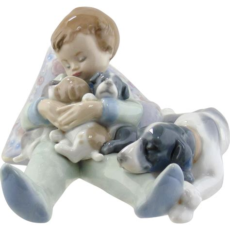 with puppies lladro figurine sleeping child with puppies from seasideartgallery on