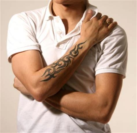 best tattoos for men in the arms tribal arm designs