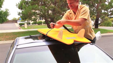 How To Put Surfboard On Roof Rack by How To Put Soft Surfboard Racks On A Car Swell