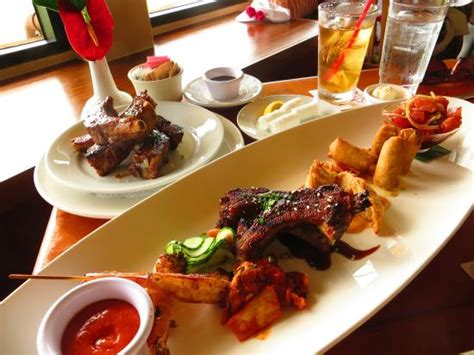 hawaiian fusion cuisine added rice to the appetizer ribs to a customized meal
