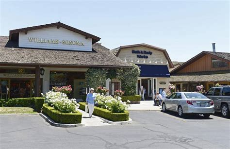 Fig Garden Shopping Center by Sidewalks Lined With Shrubs And Flowers On Posts And